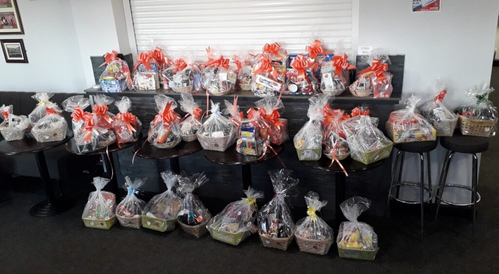 Photo of many hamper baskets made by Eden Hill Peoples Centre for their 'A Christmas Gift' campaign