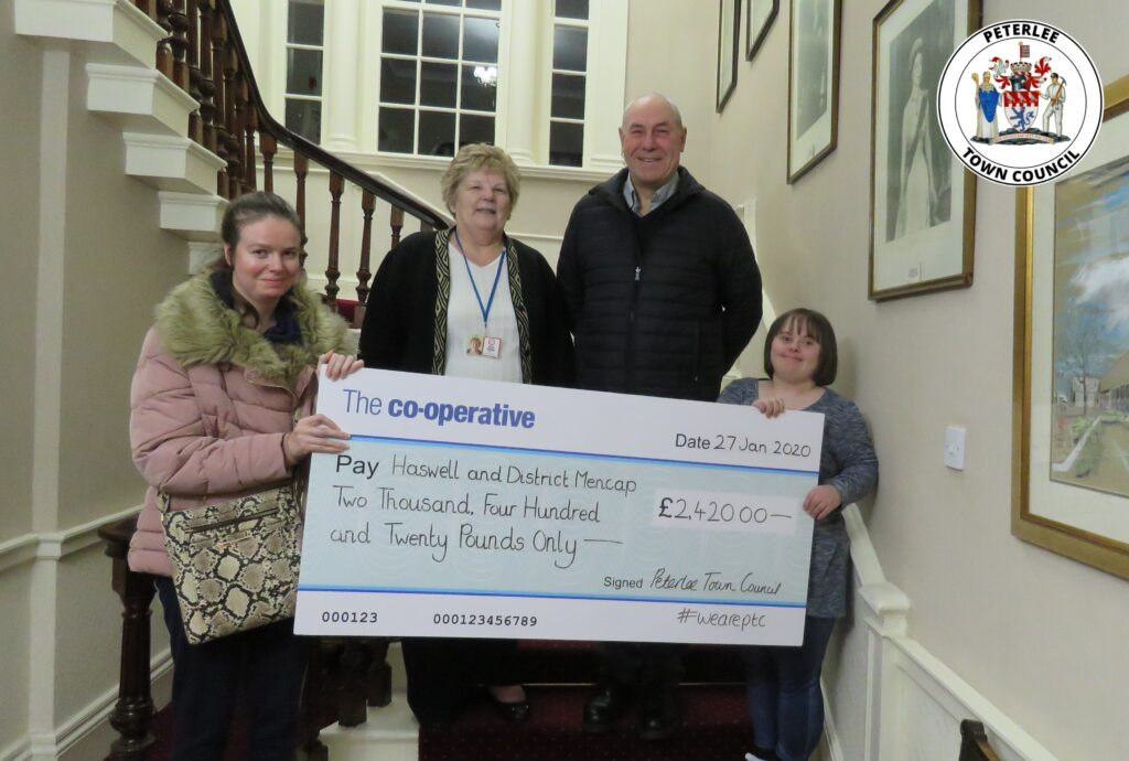 Photo of your Mayor and members of Haswell and District Mencap with a large cheque