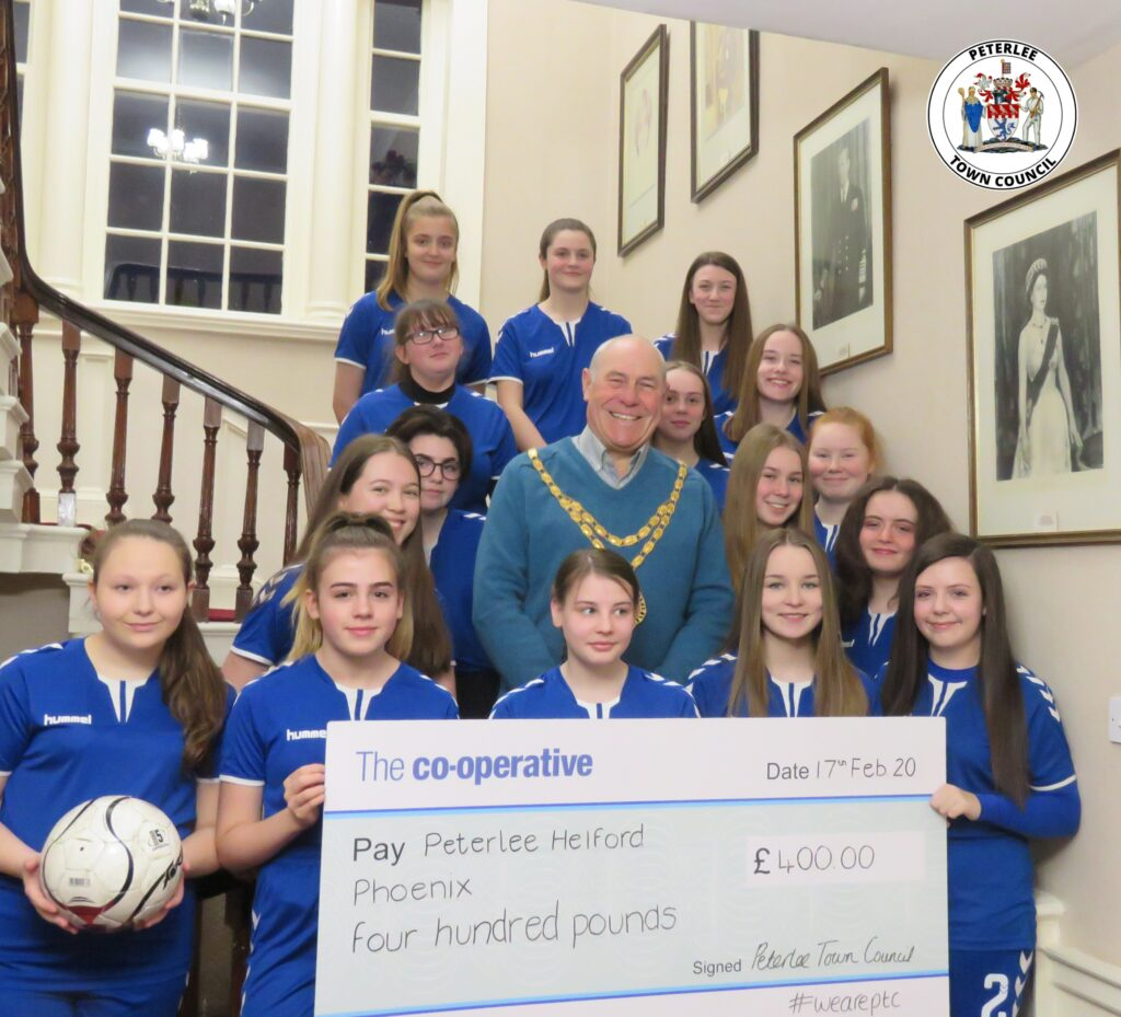 A photo of your Mayor with members of Peterlee Helford Phoenix holding a large cheque